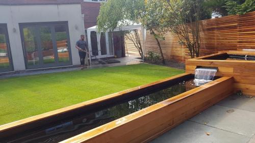 garden landscaping red cedar wood sleeper border planting
