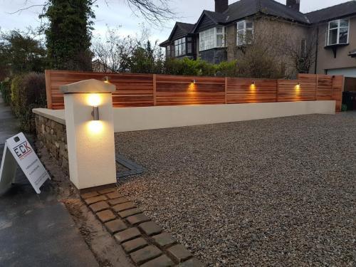 Landscaping groundworks driveway gravel cobbles red cedar fencing lighting dry stone walling krender k render